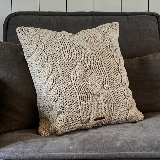 hygge living room ideas, cream knitted cushion