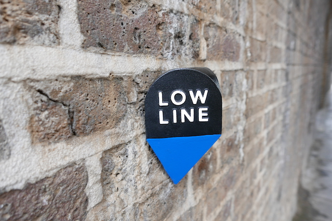 ten unusual things to do in bankside london low line walking signs