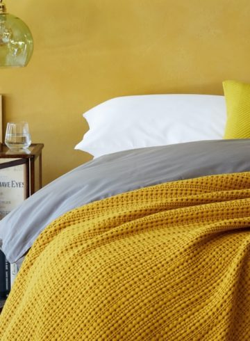 gorgeous glowing golden colour bedspreads feature image