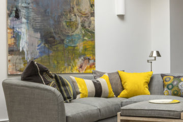 pantone grey and yellow living room ideas feature image