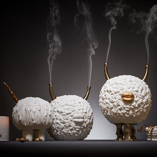 lobject monster incense burner round shapes with gold horns and lips, smoke radiates through the horns